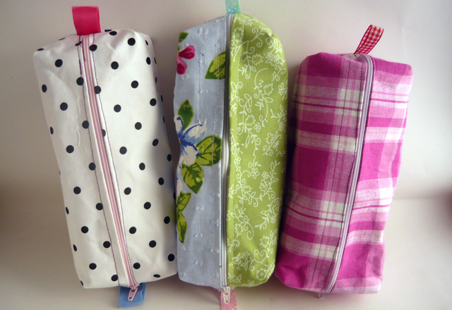 children sew pencil cases